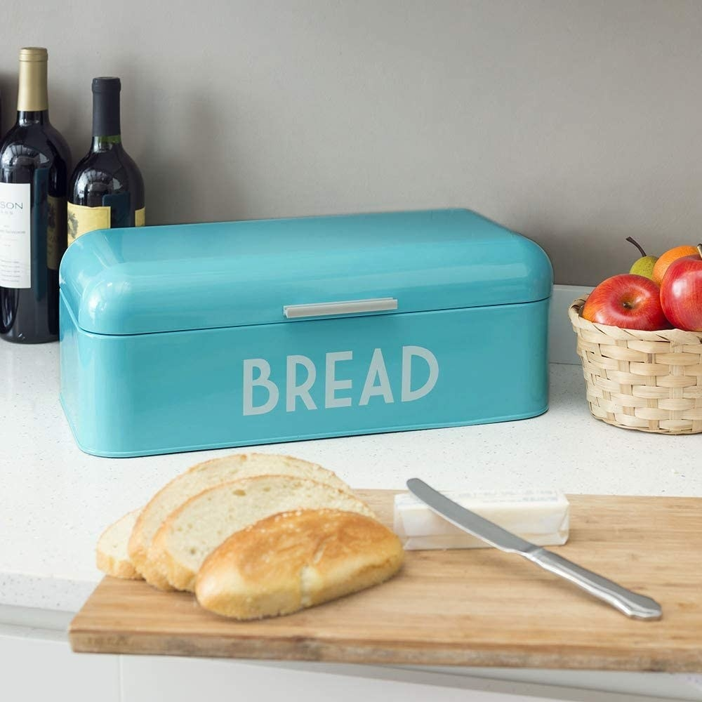 a turquoise box that says bread on it in white