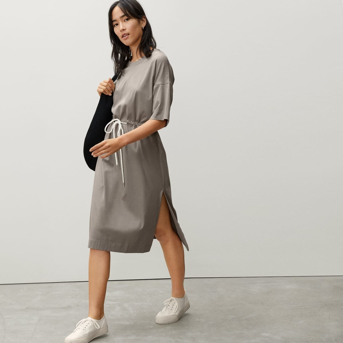 model in the gray short-sleeve dress with slits at the side