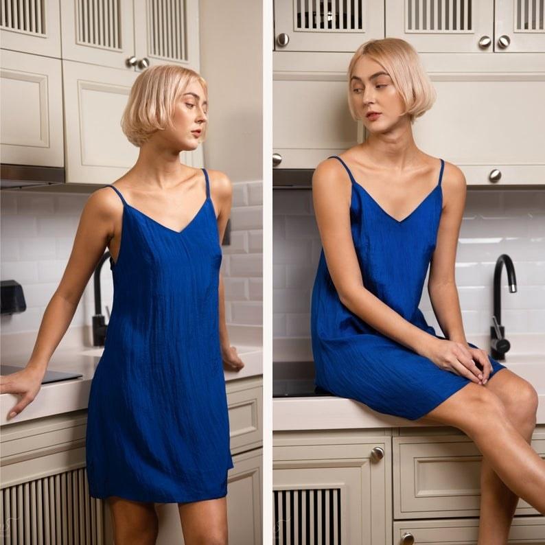 model in short royal blue slip