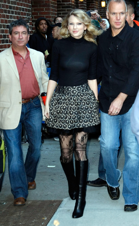 Taylor Swift in a turtleneck & skirt leaving a talkshow