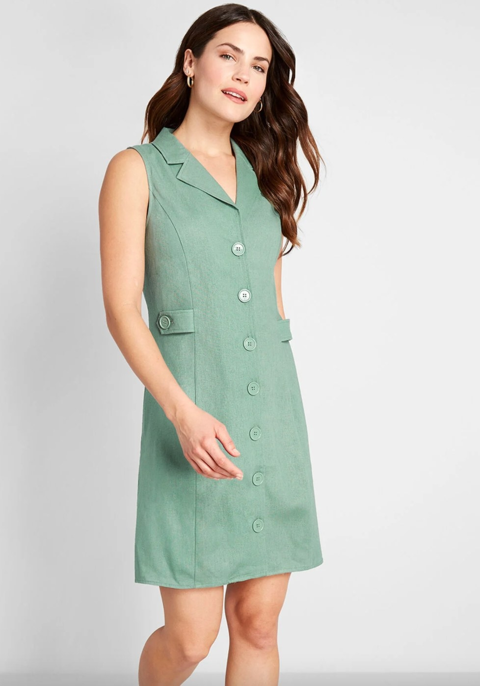 The sleeveless button-front dress in sea green
