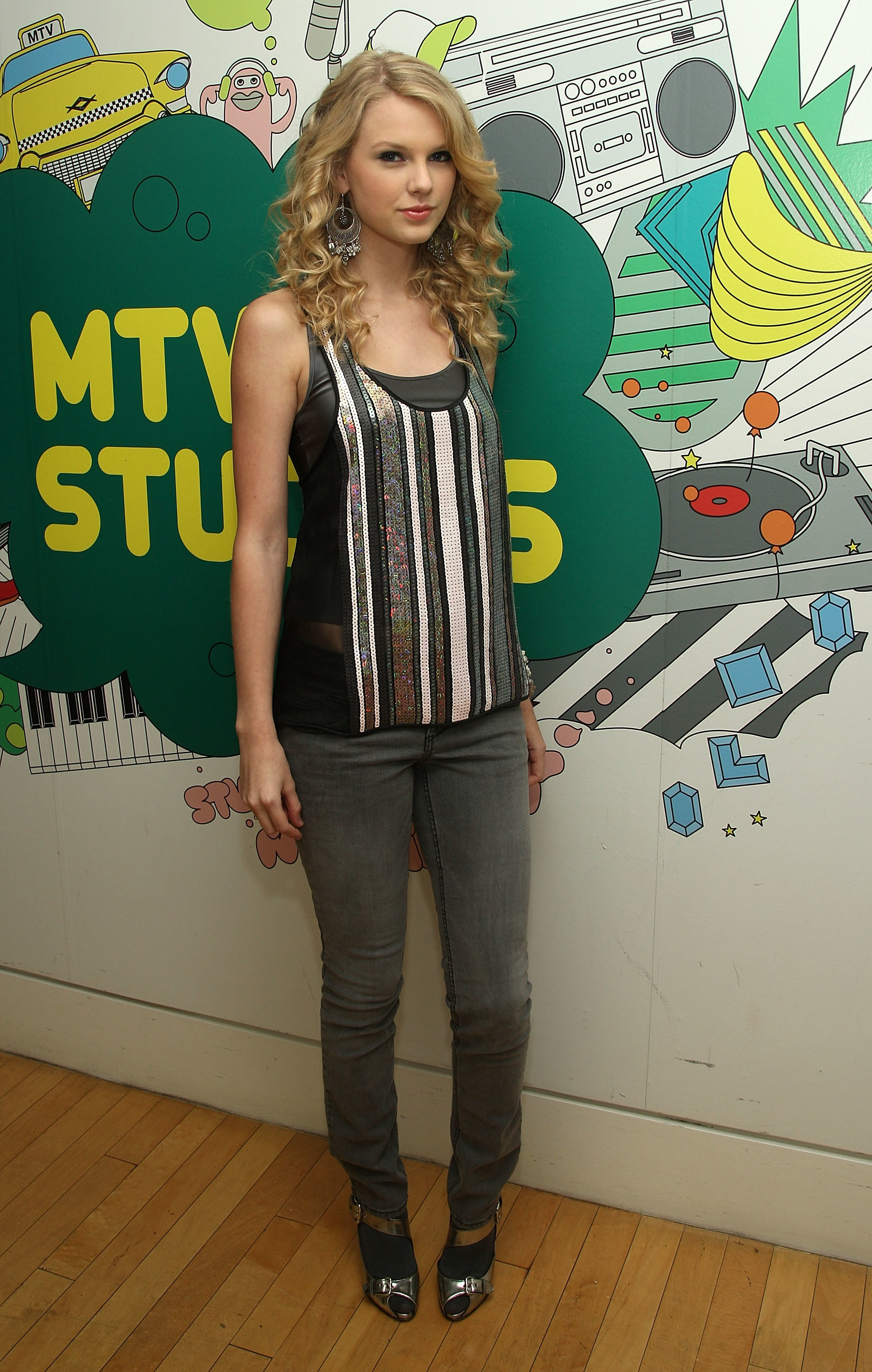 Taylor Swift in sparkly tank top and grey jeans