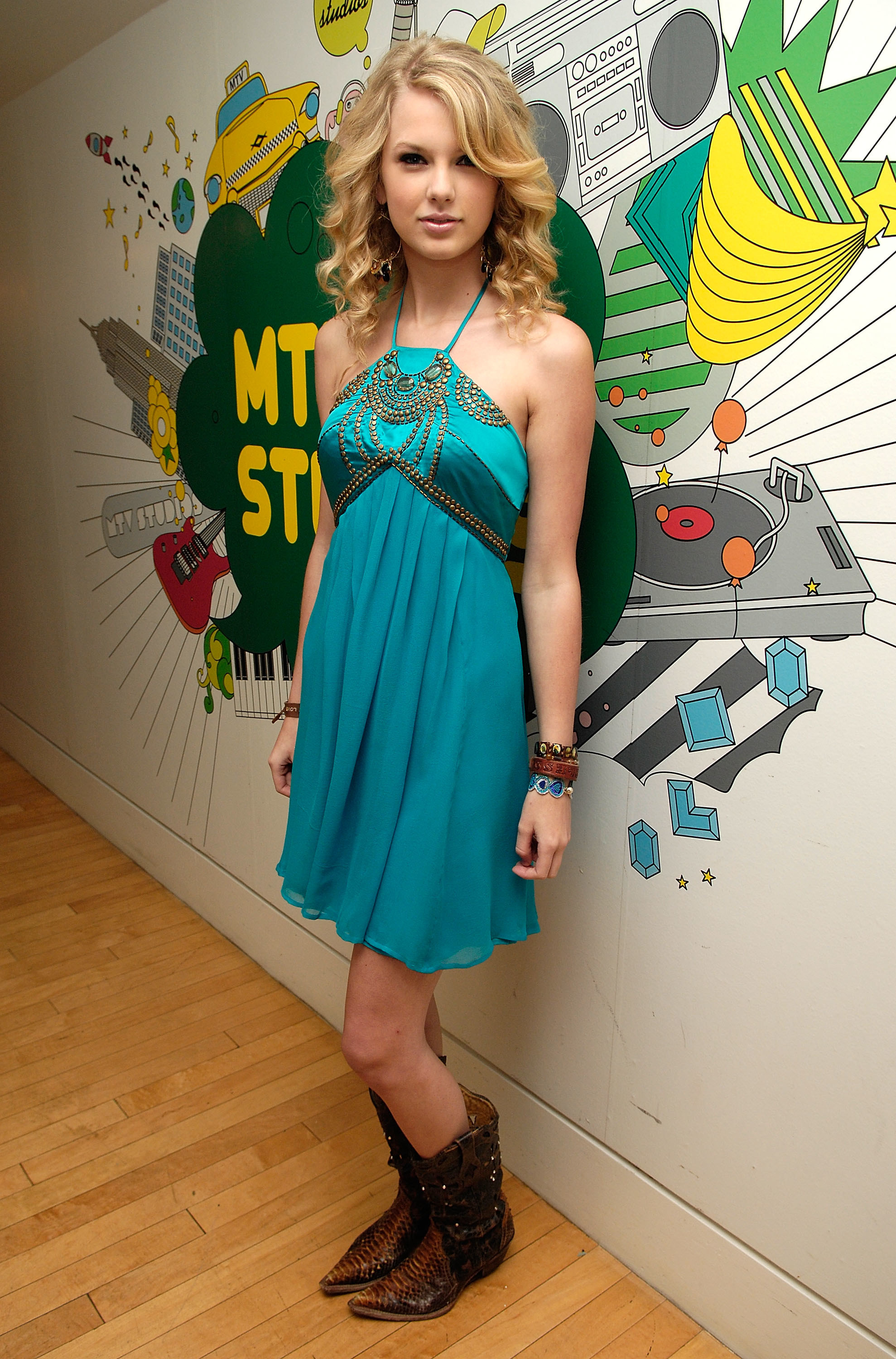 Taylor Swift in blue dress and cowboy boots