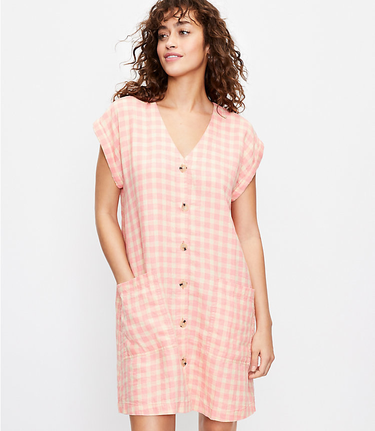 model in pink gingham dress with large rectangular front pockets
