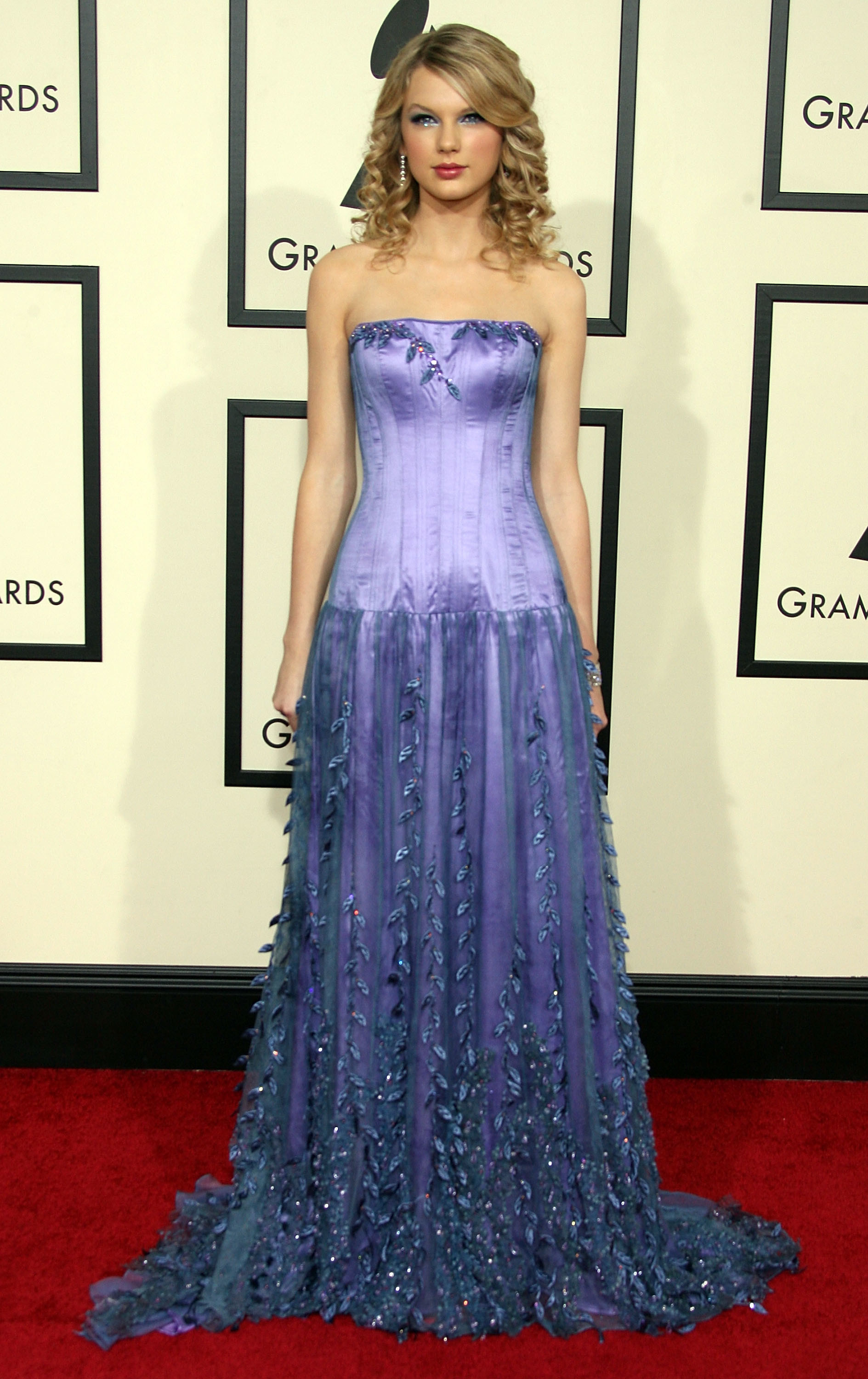 Taylor Swift at the 2008 Grammy awards in a long purple sparkly dress