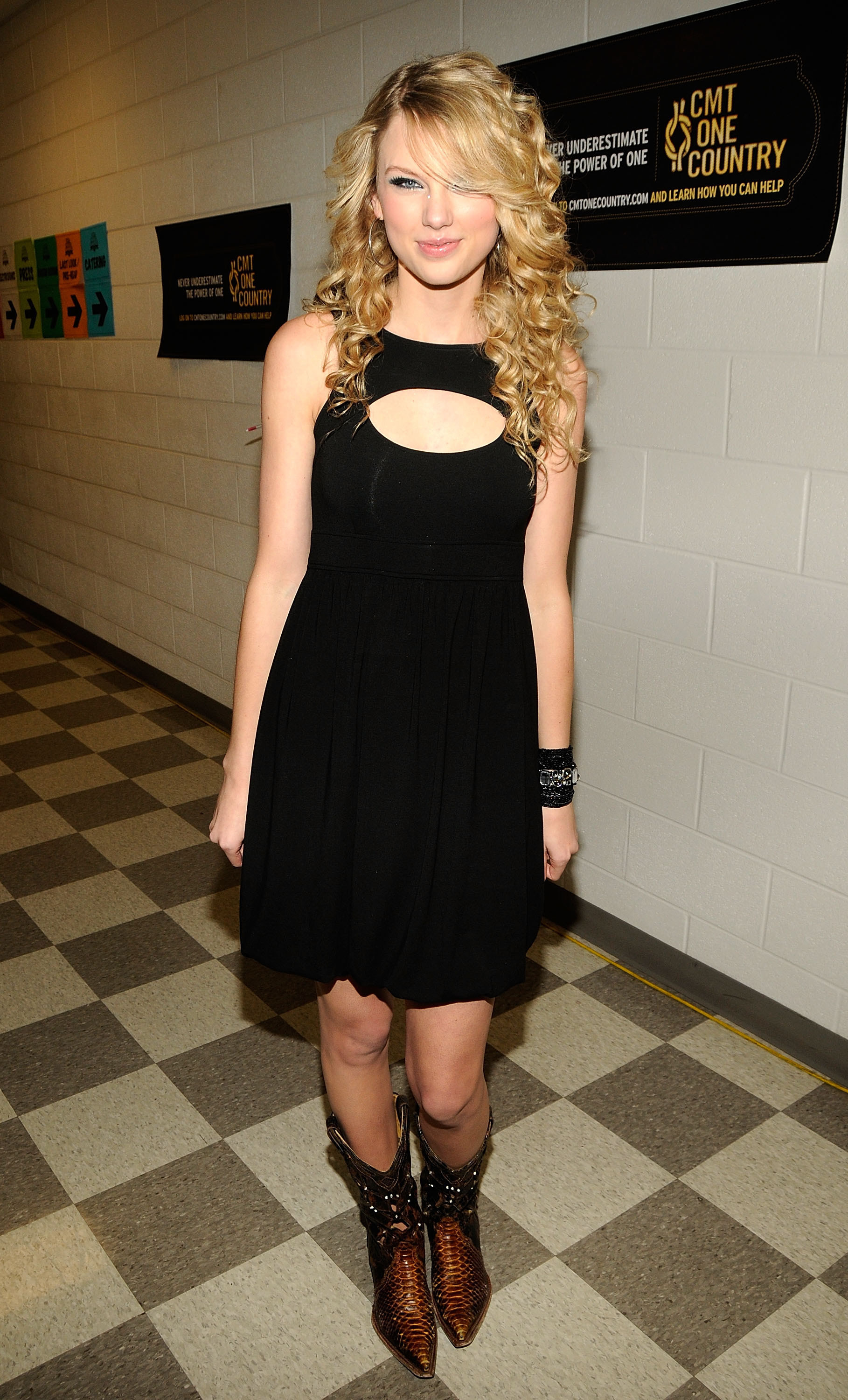 Taylor Swift posing backstage at the CMT Awards