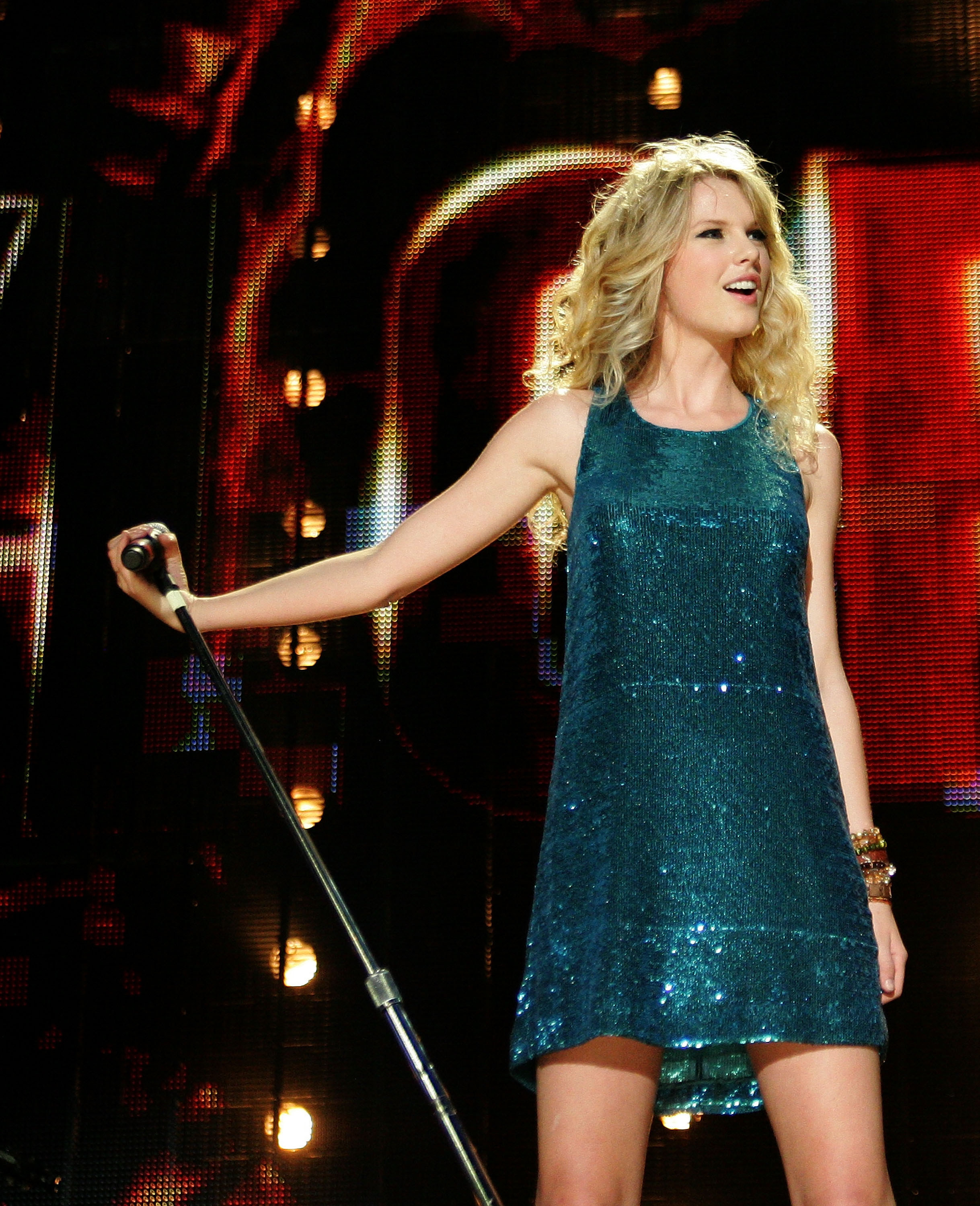 Taylor Swift performing in a sparkly blue dress