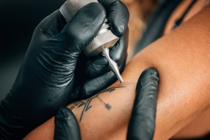 a tattoo being placed on an arm