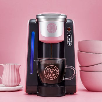 a pink and black k-cup coffee machine