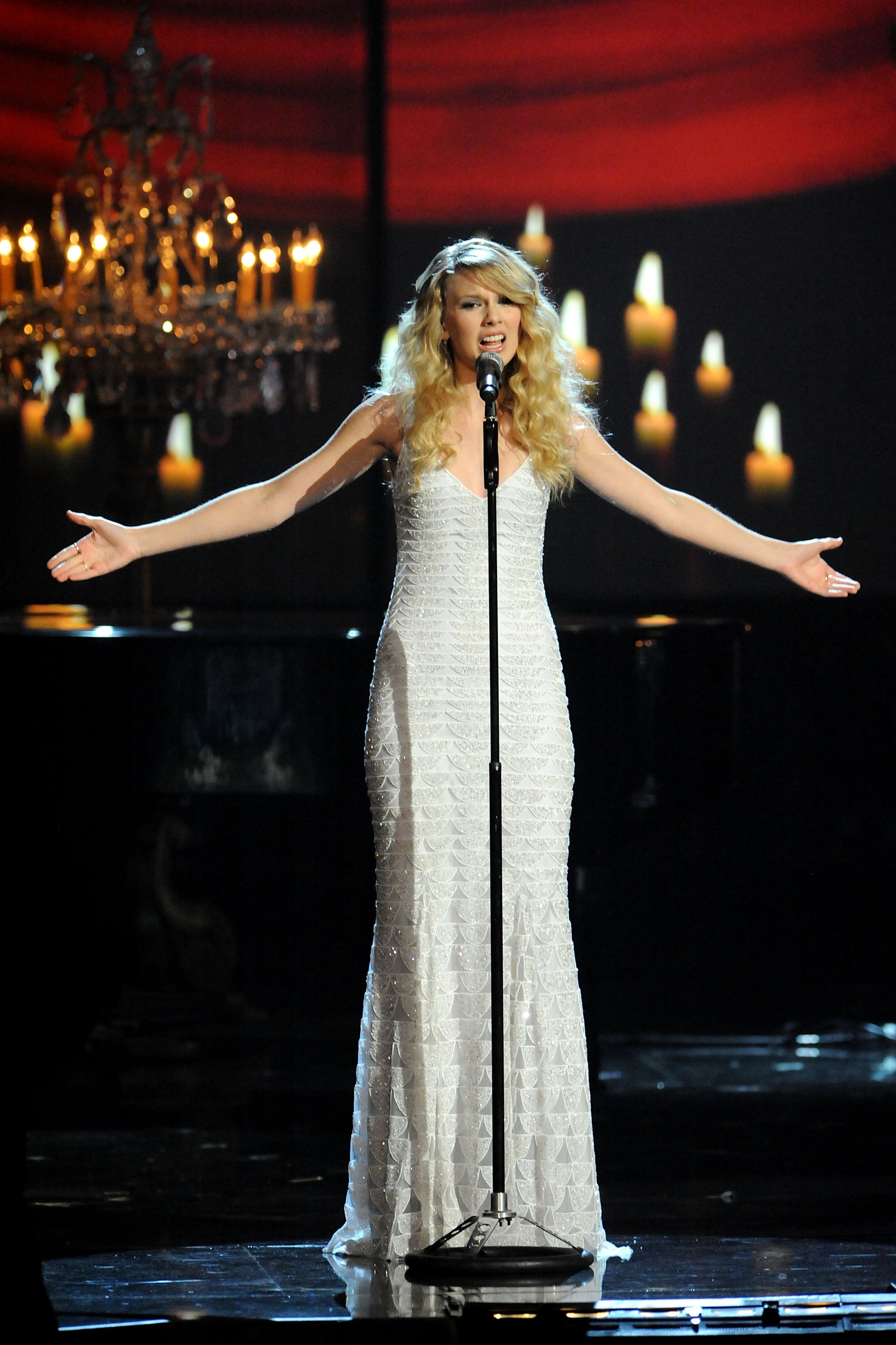 Taylor Swift performing White Horse at the American Music Awards in a long white dress