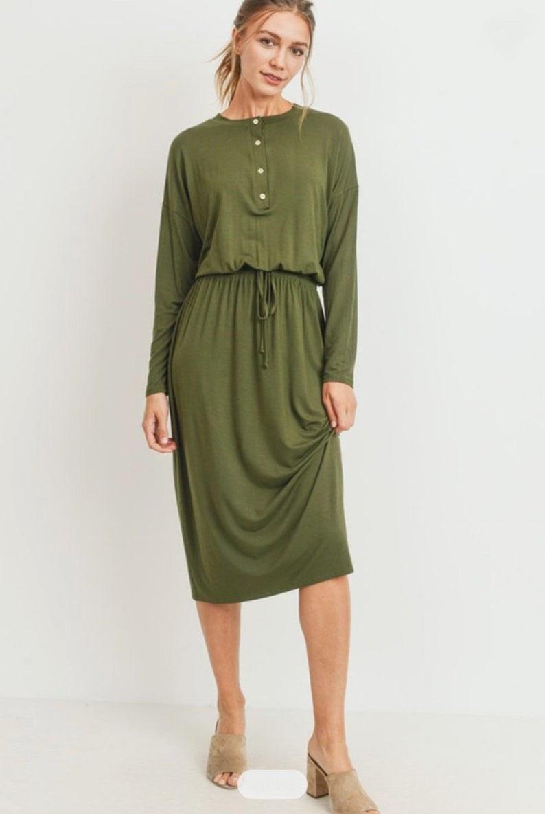 model in the long-sleeve, knee-length olive green dress