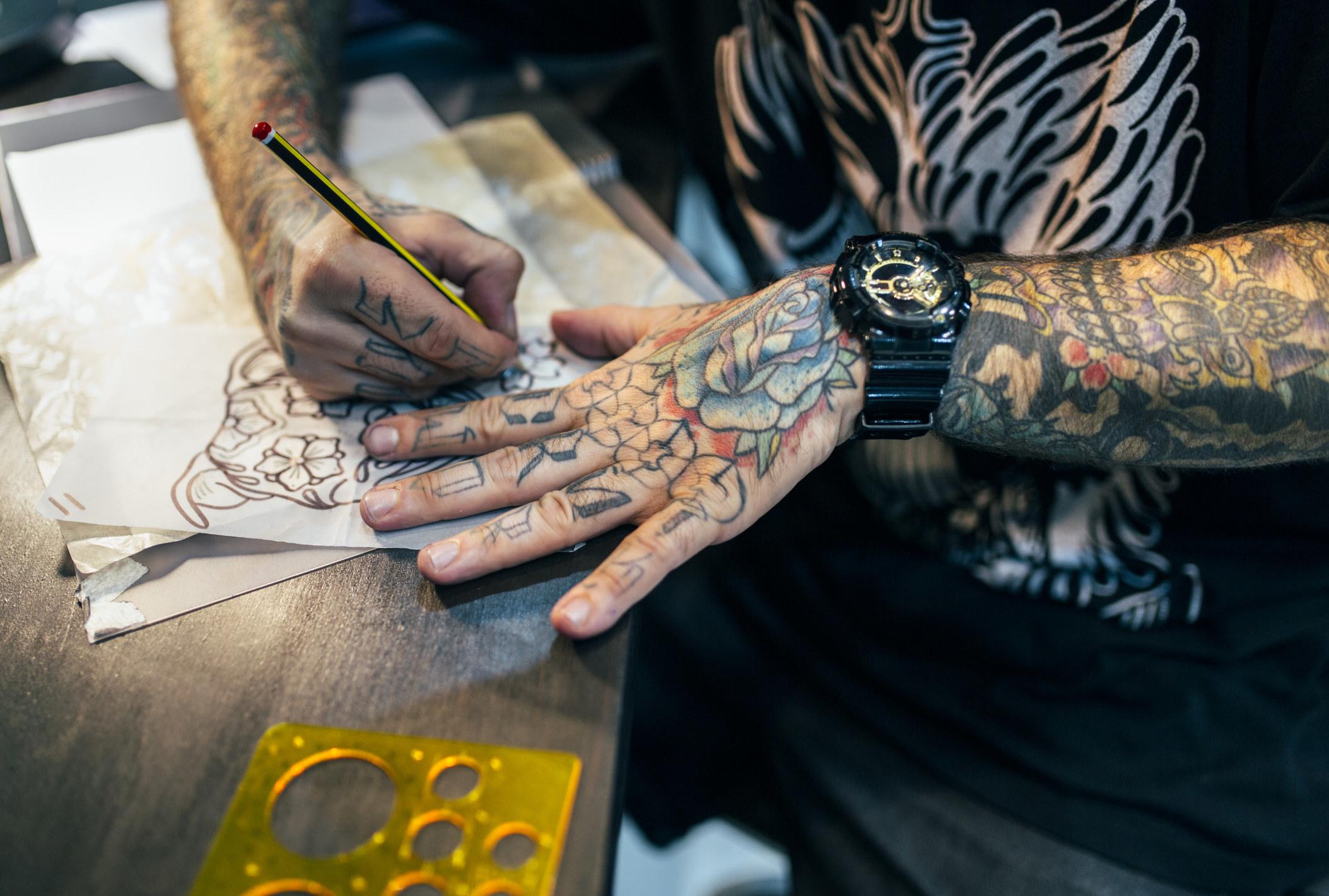 a tattoo artist doing a sketch