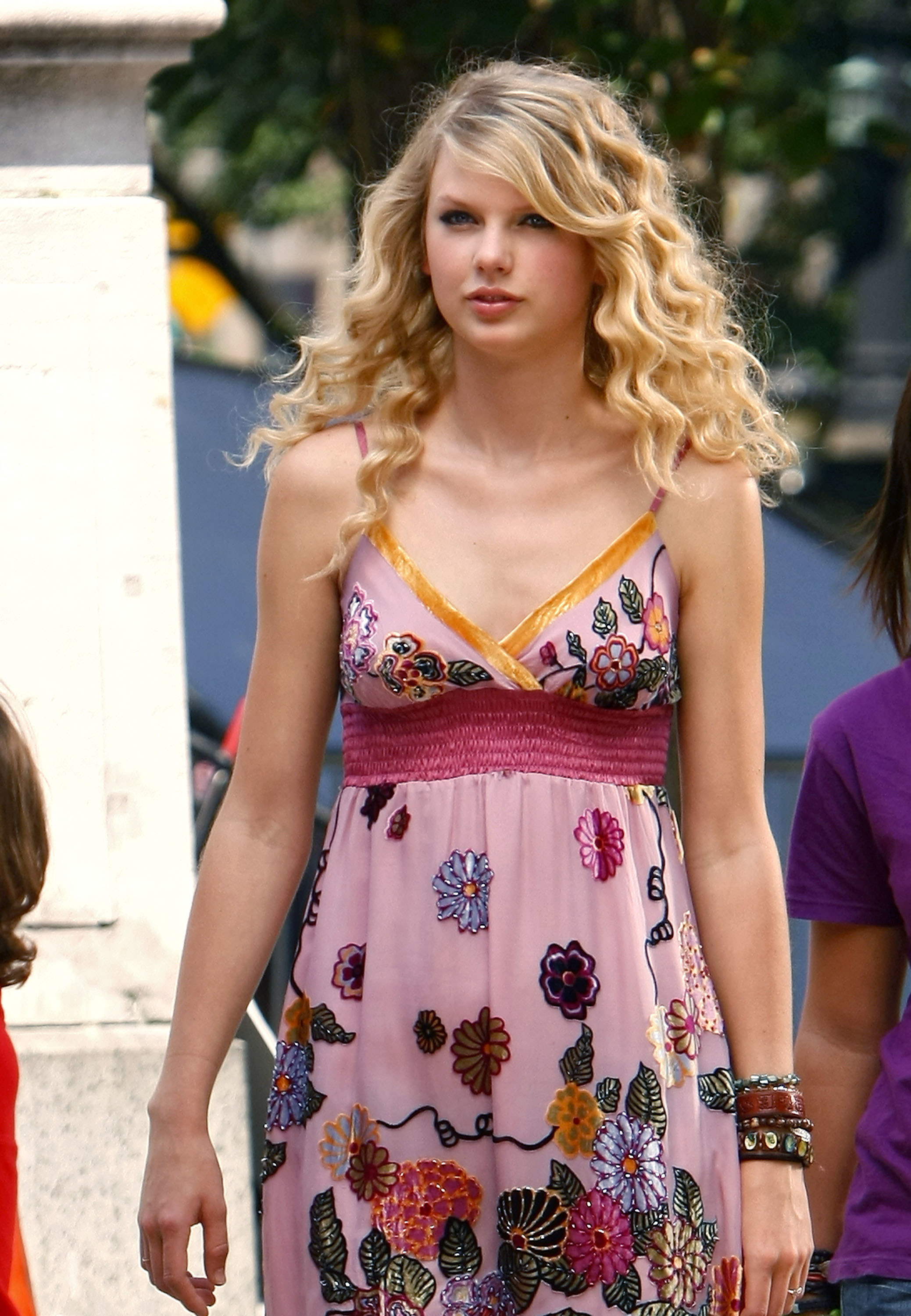 Candid of Taylor Swift in a pink floral dress