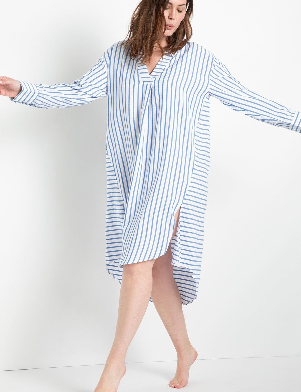 model in knee-length blue and white striped long-sleeve dress