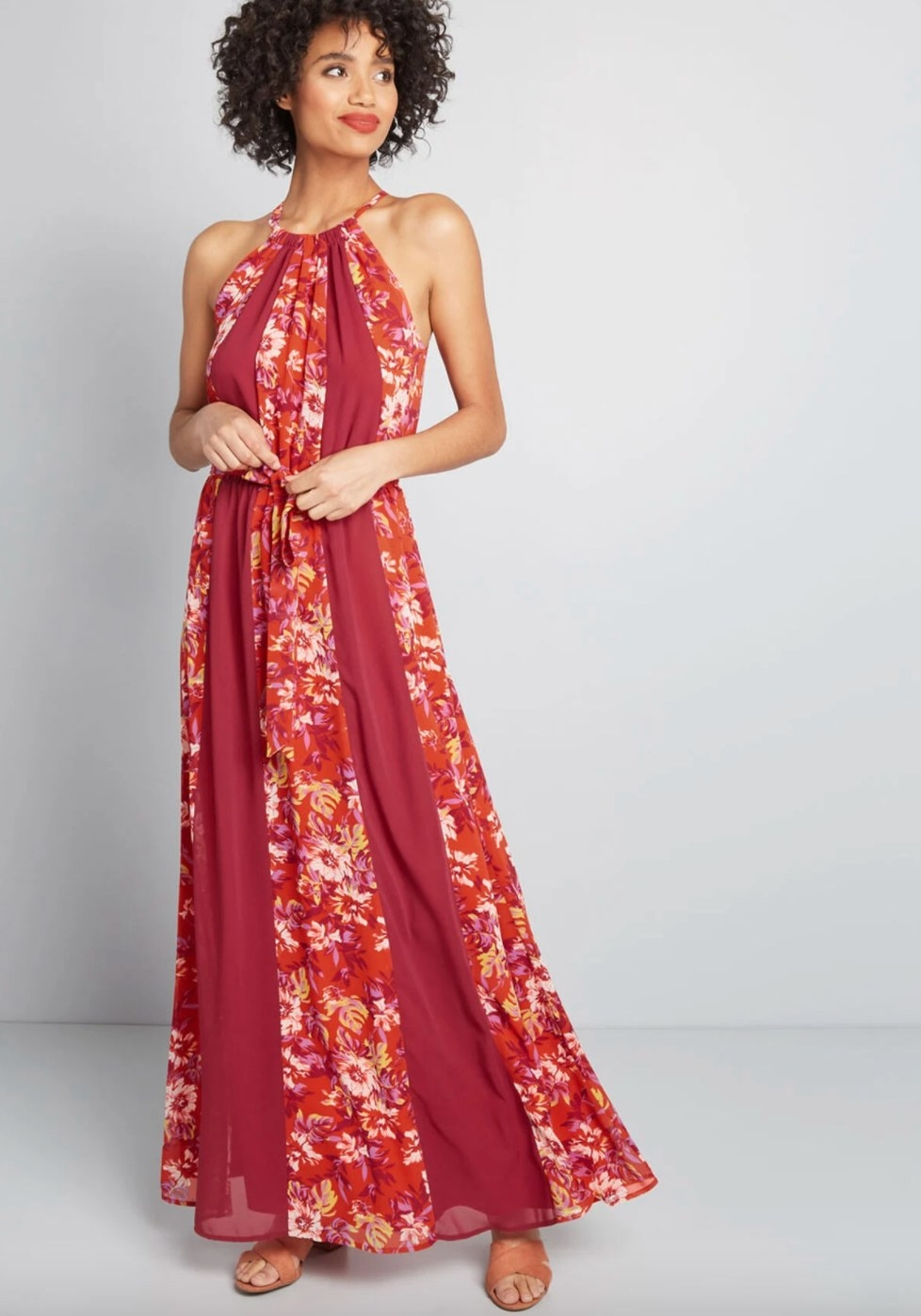 The chiffon maxi dress in stripes of solid red and red floral