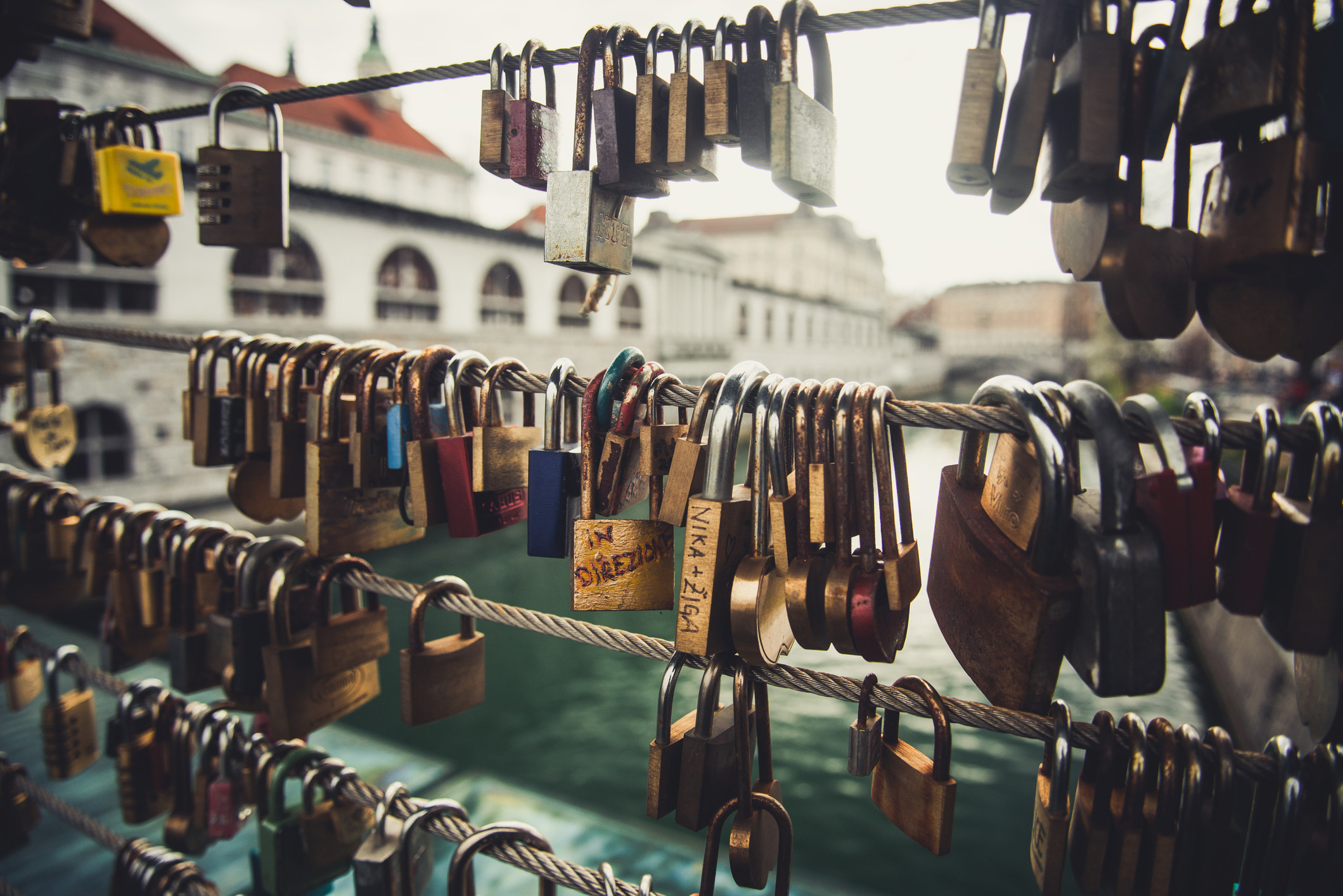 A bridge with many locks attached to it,