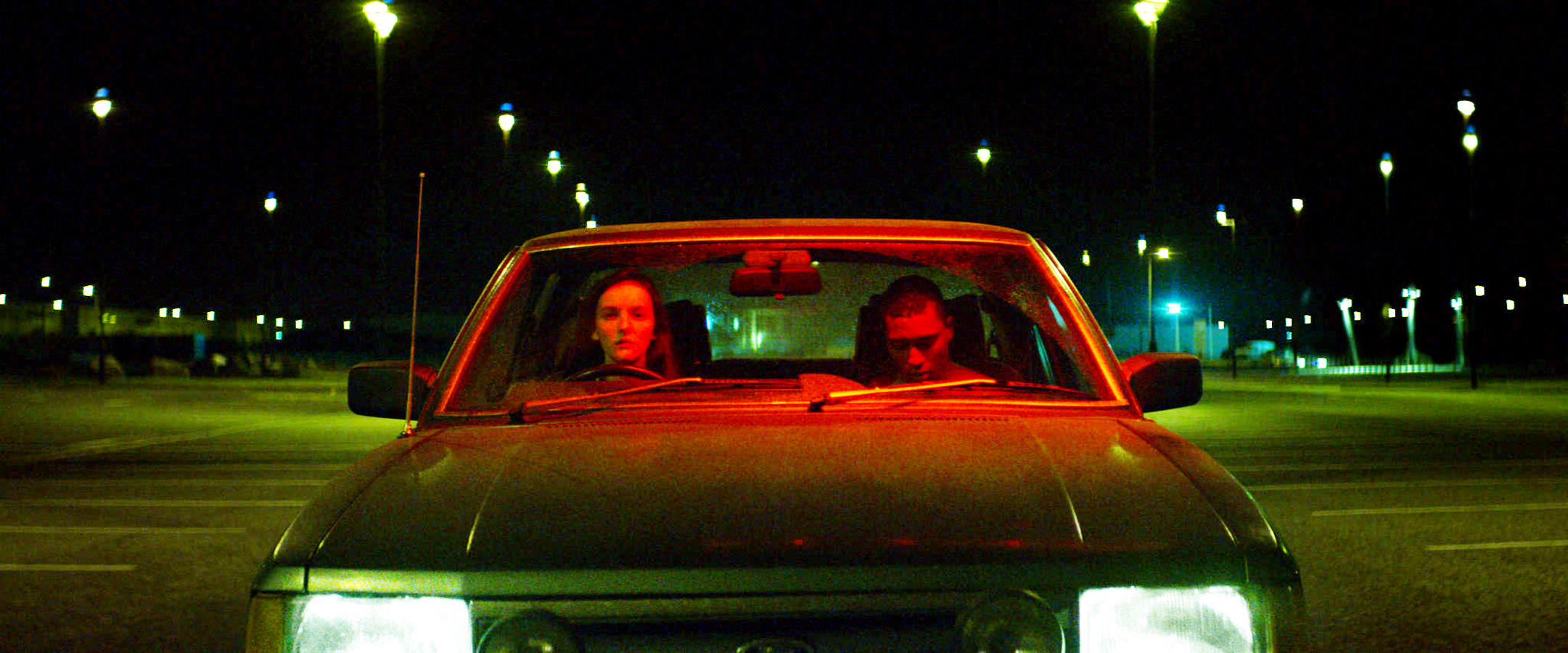 Skelly in Kissing Candice in a car with man in a parking lot