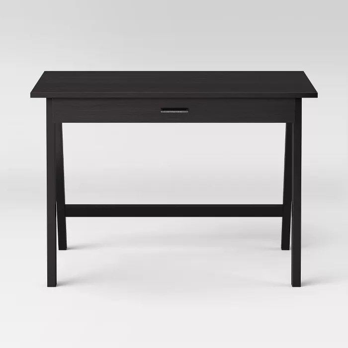 The black desk with a drawer