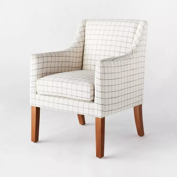 The white chair with a navy plaid