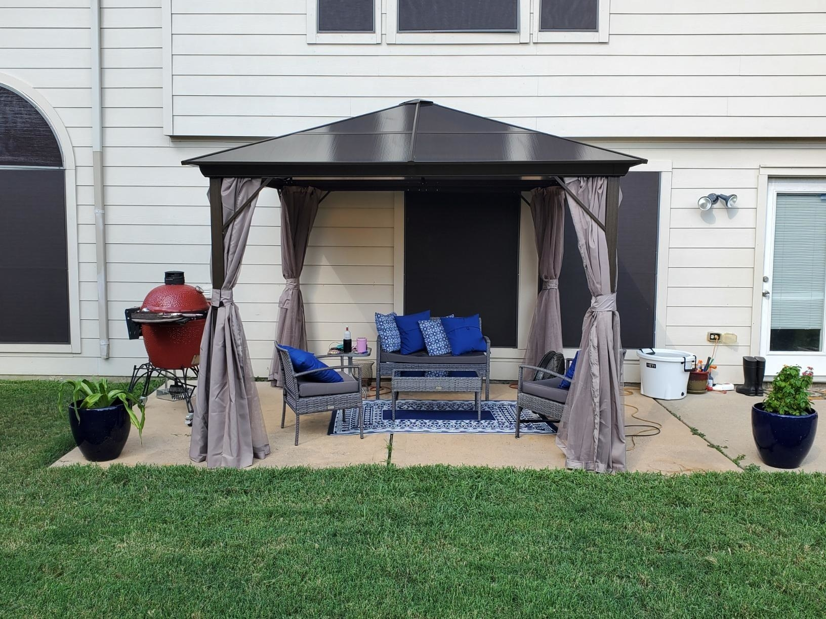 a gazebo with curtains tied back