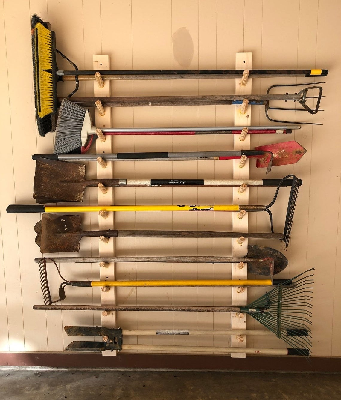 the wood rack holding about 11 yard tools
