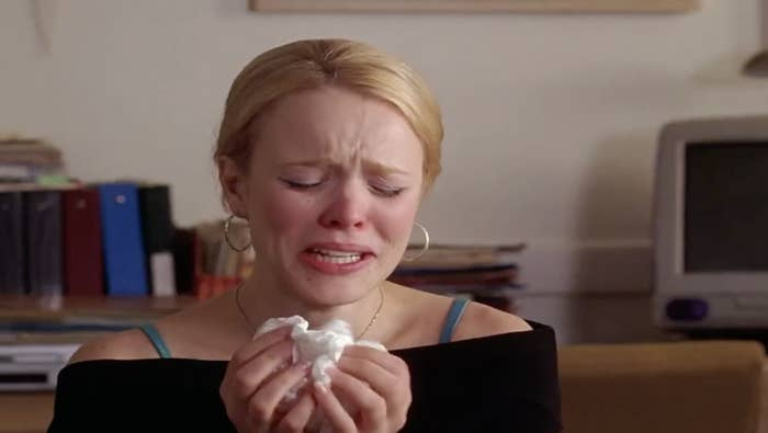 Woman crying into a tissue
