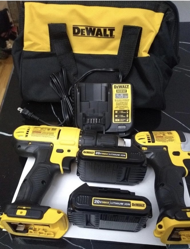 A reviewer's yellow power drill tool kit