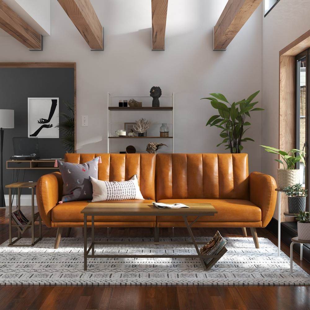 the camel faux leather futon in a living room