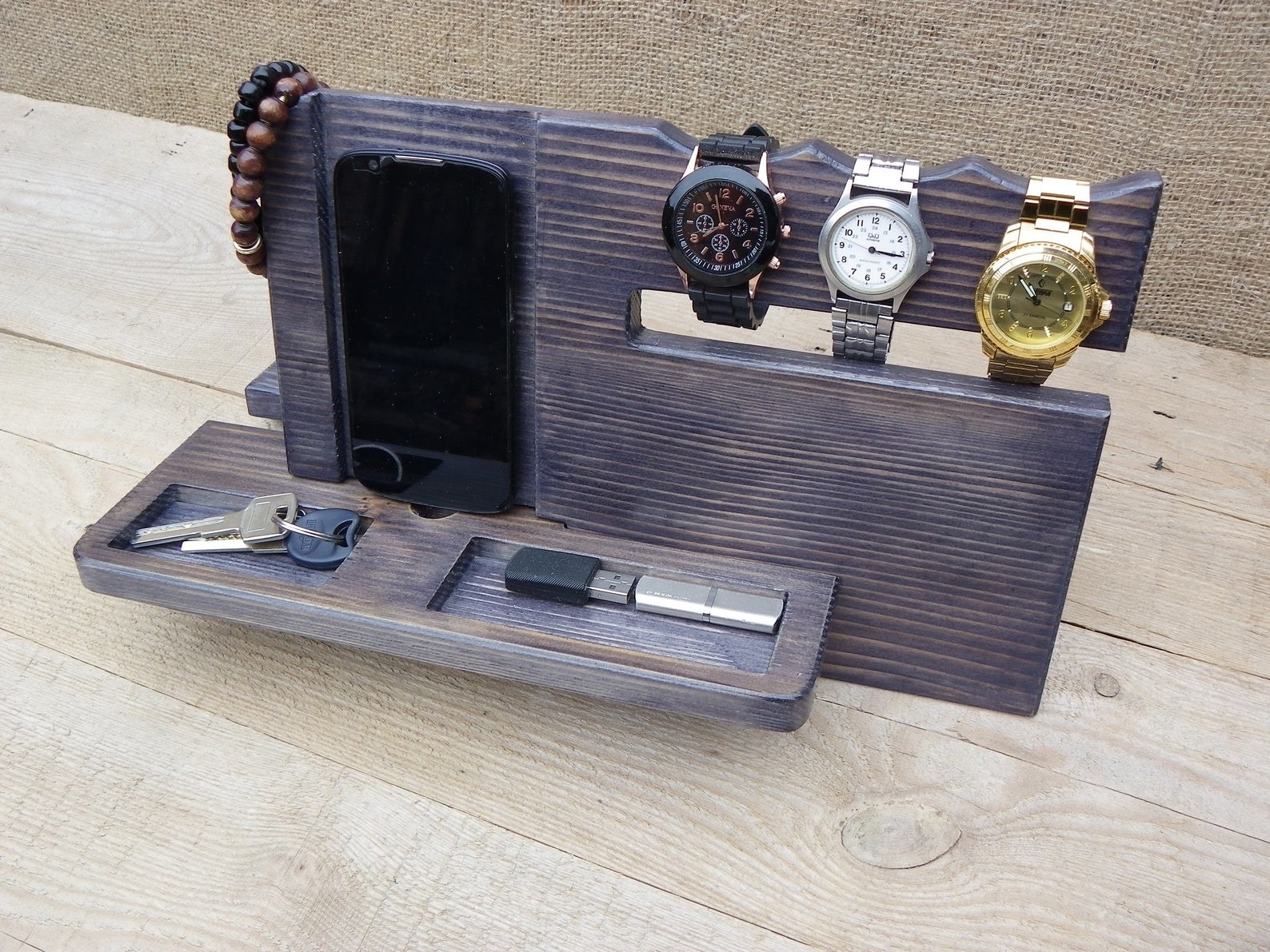 organizer with slots for three watches, plus some compartments