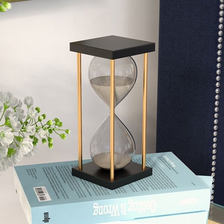 The hourglass on top of a stack of books