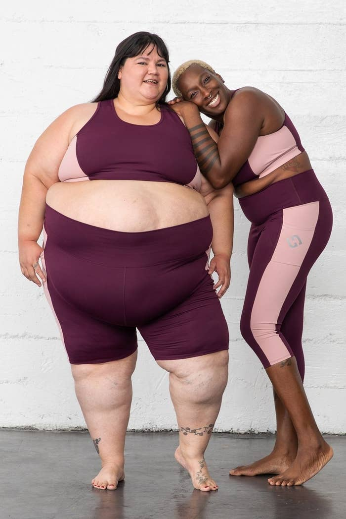 two plus size models wearing the burgundy superhold sports bra
