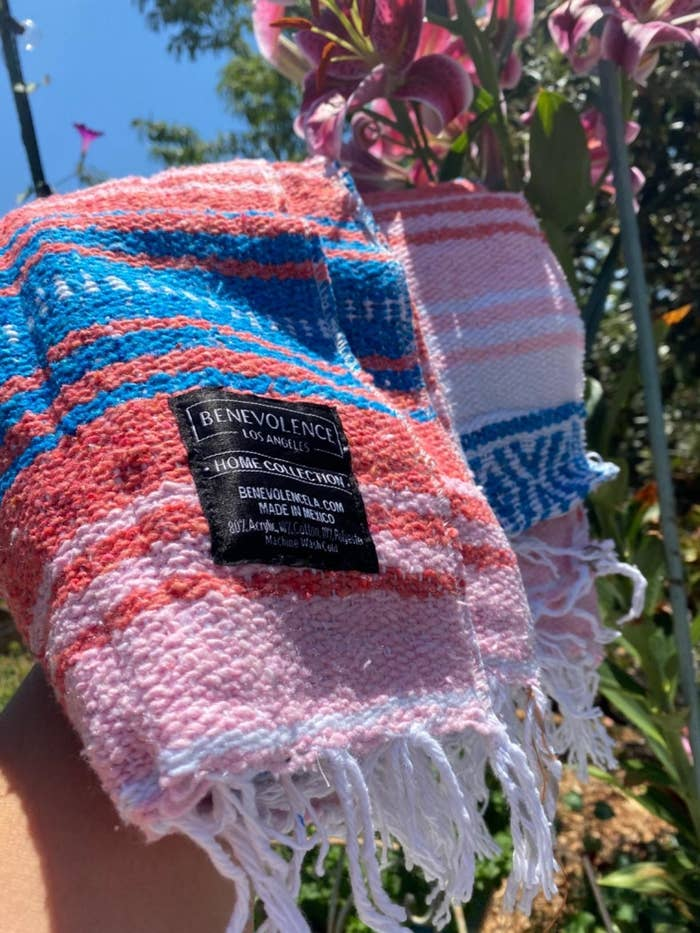 a striped red, blue, pink, and white blanket