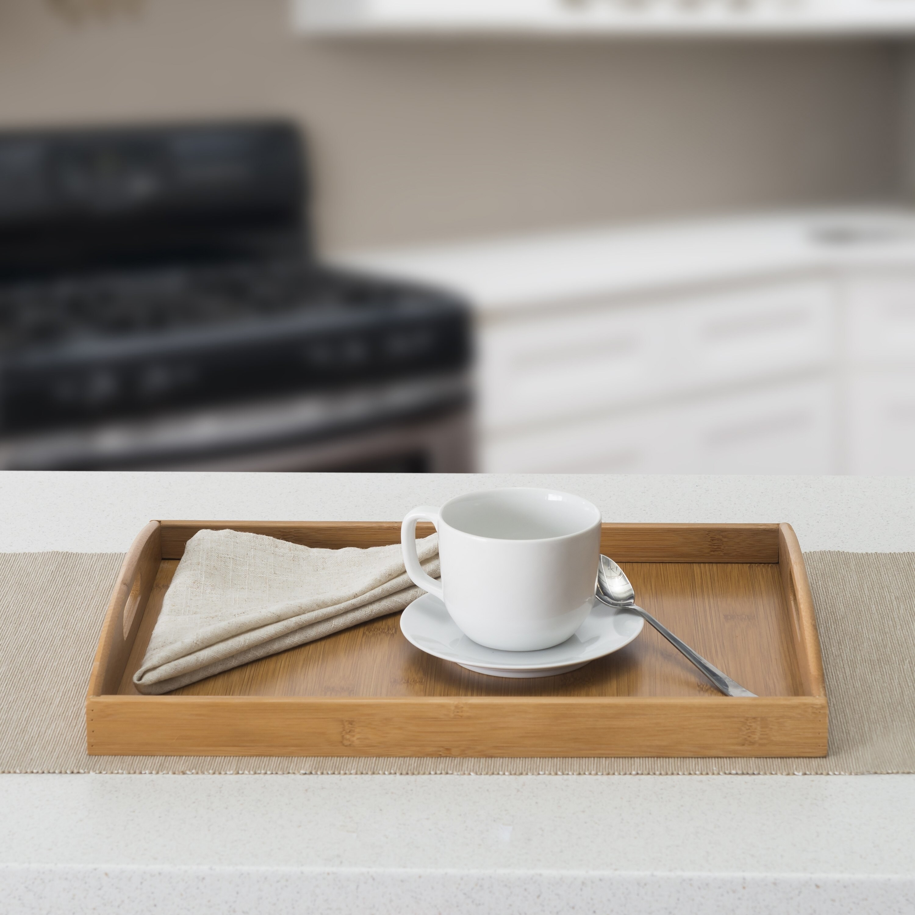 The serving tray with a coffee cup and napkin on top