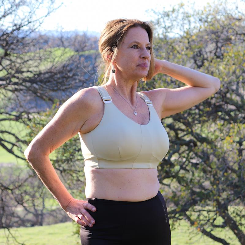 a model wearing the matcha moss rise bra