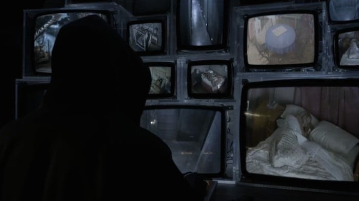 A watching the security footage of the bedrooms