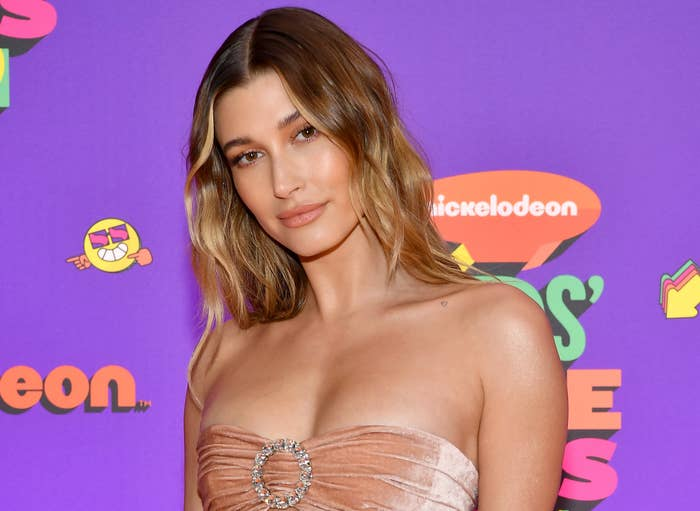 Hailey smiles while on a red carpet