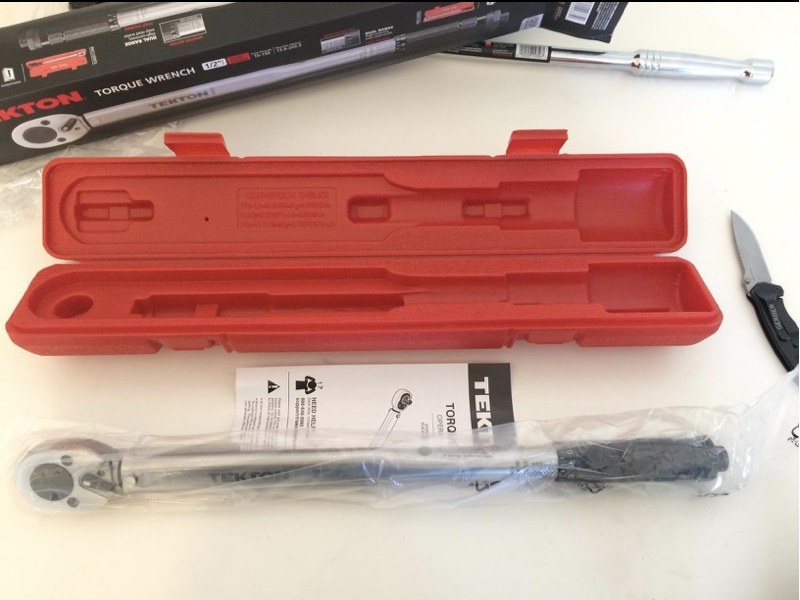 A reviewer's torque wrench and case on a table