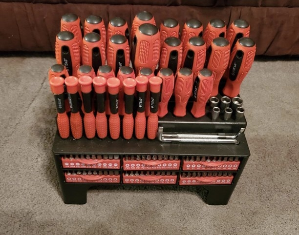 A reviewer's 100-piece red and black screwdriver set