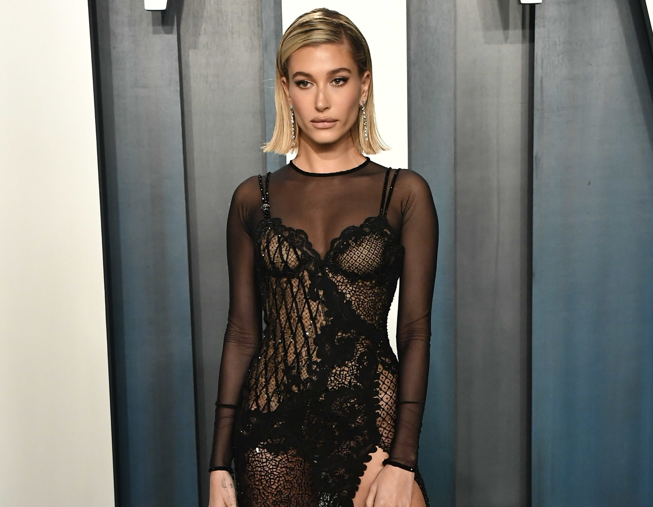 Hailey wears a sheer back dress to an event