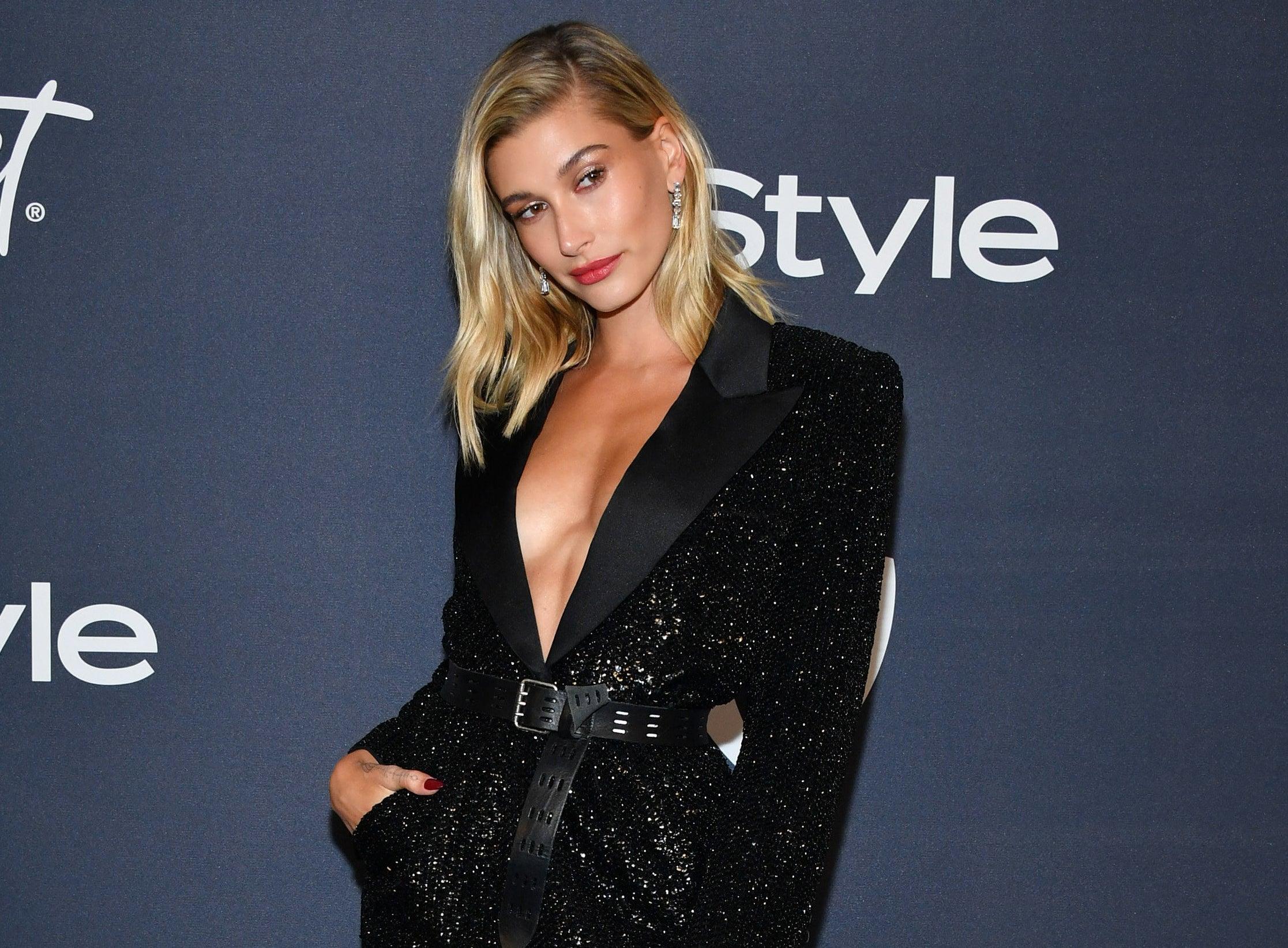Hailey wears a black blazer dress to an event