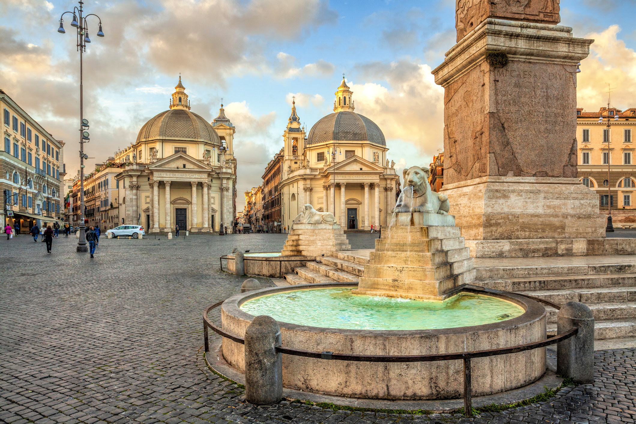 A Roman plazza with sculptures and fountains.
