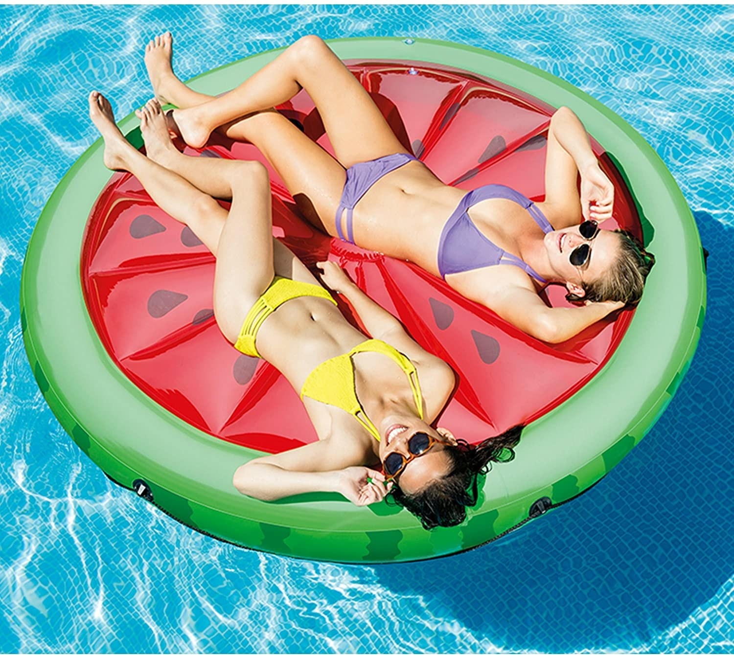 two models on a watermelon pool float