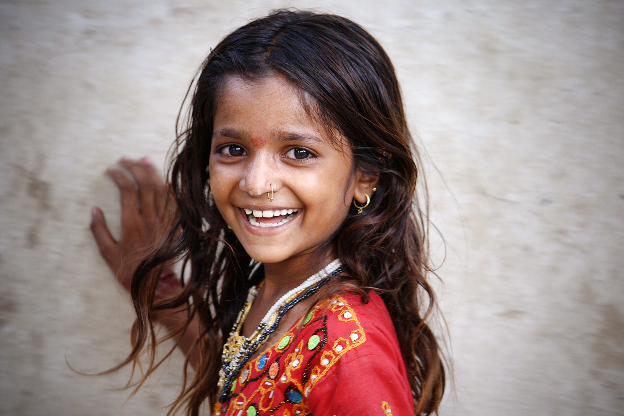 An Indian girl smiles