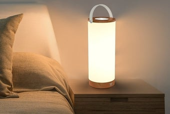the lamp sitting on a nightstand