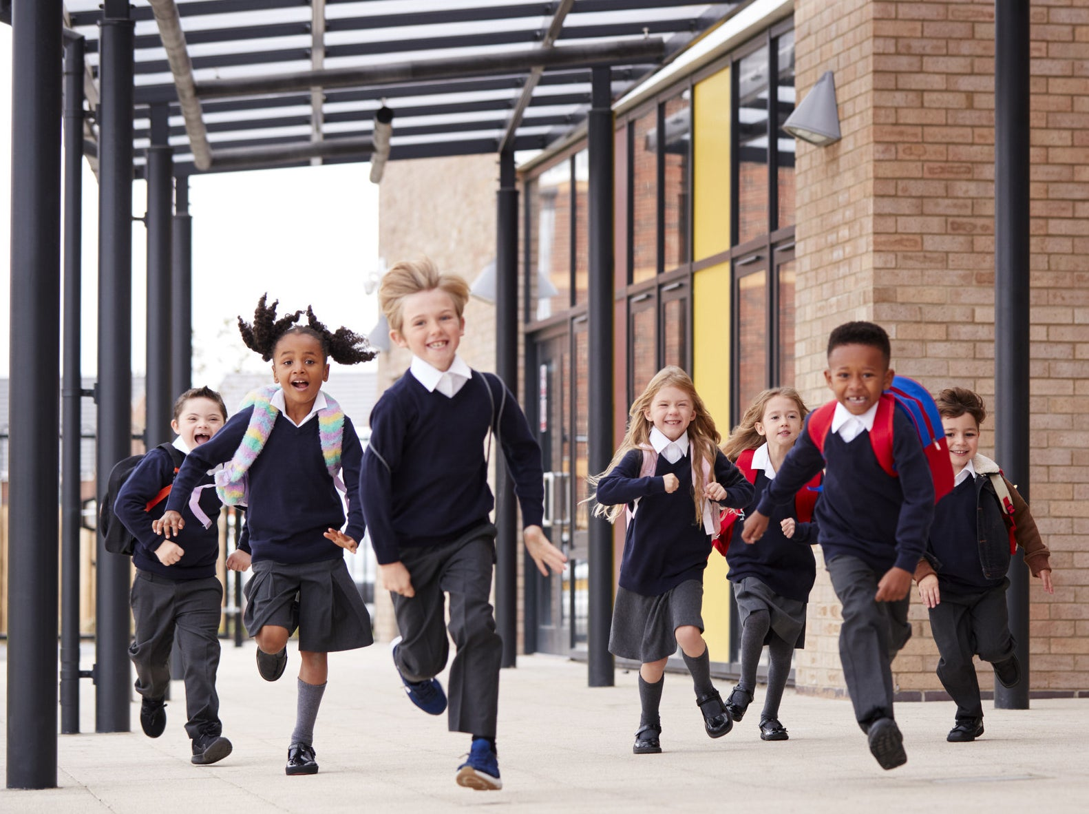 Schoolkids run out of the school after the final bell rang