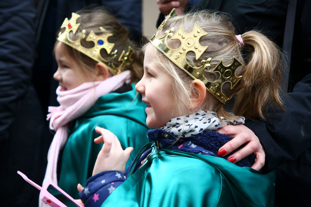 Two Polish girls wear crowns at a Three Kings ceremony