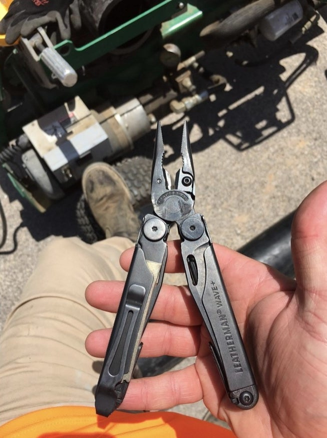 A reviewer holding their multi tool in their hand