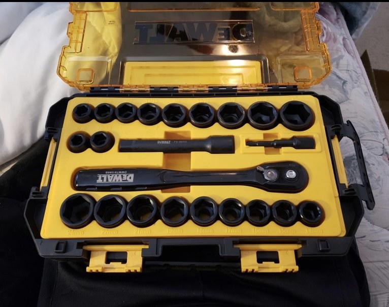 A reviewer's open twenty three piece socket set