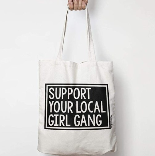 """The tote bag which reads """"support your local girl gang"""""""