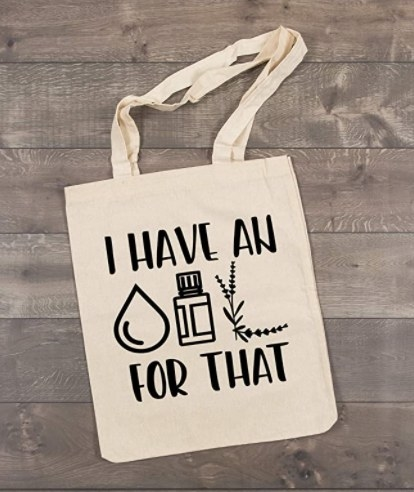 """The tote bag which says """"I have a *symbols for liquid, oil, and plant* for that"""